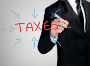 45899099 - business man close-up write taxes word